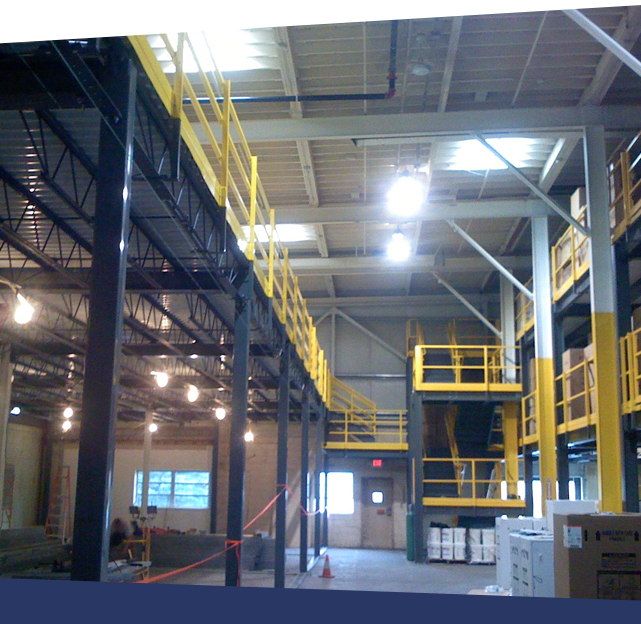 Custom industrial mezzanine with high walls and industrial stairs