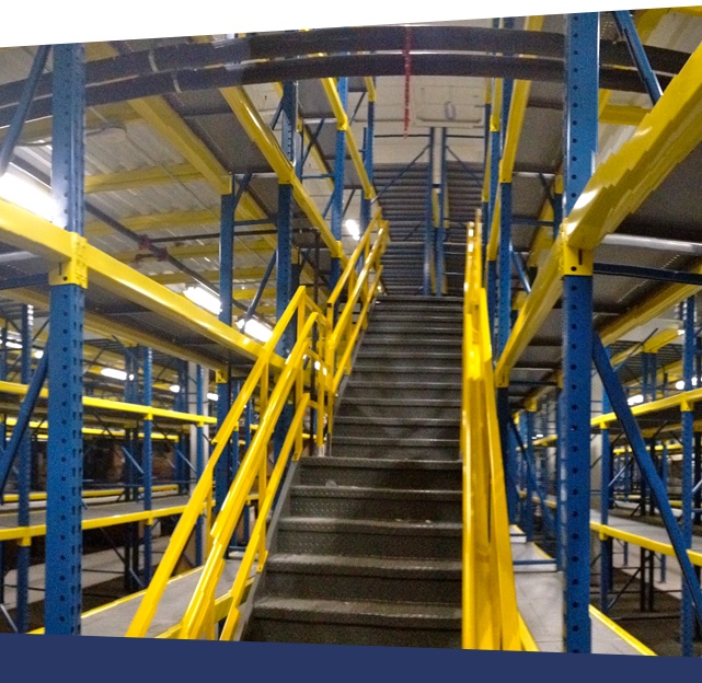 Custom rack-supported mezzanine and industrial stairs